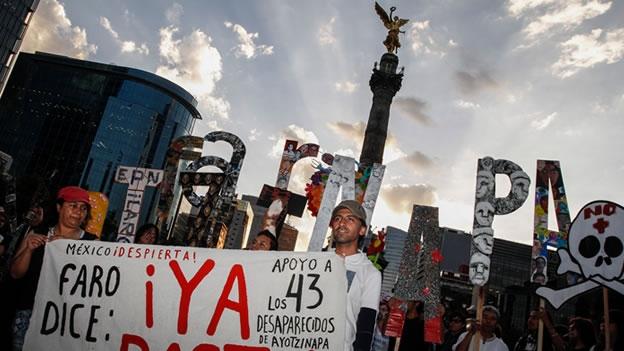 ayotzinapa-marcha-angel.jpg