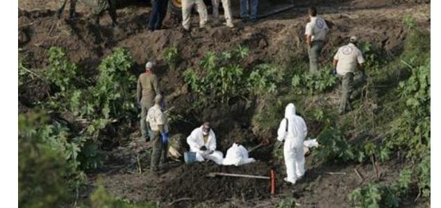 cadaveres-tumbas-mexico-reutersAlejandroAcosta.jpg