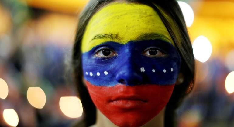 venezuela-protesta-manifestante-bandera-reuters.jpg