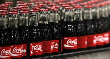 La embotelladora  de Coca-Cola planea nuevas adquisiciones