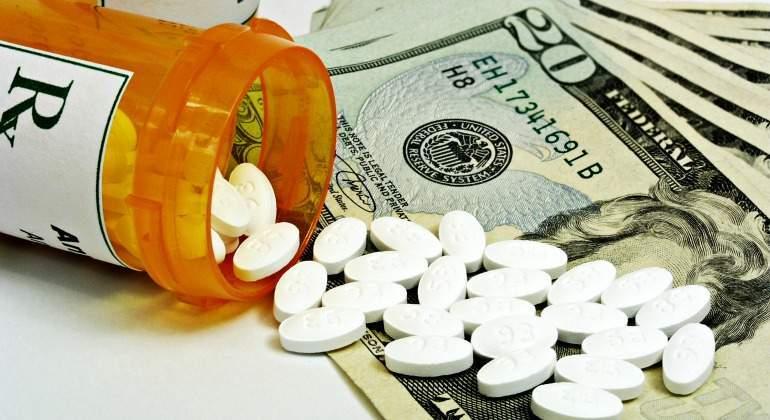 farmaceuticas-medicina-sanidad-pastillas-dolares-bote-dreamstime.jpg